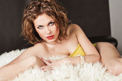 Woman in lingerie lying on fur Stock Photo