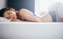 Woman in lingerie lying in her bed Royalty Free Stock Photo