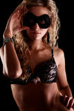 Woman in lingerie and mask Stock Images