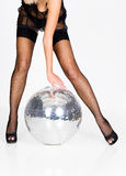 Woman in lingerie and mirror ball Stock Images