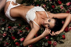Woman in lingerie with roses Royalty Free Stock Images