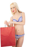 Woman in lingerie with shopping bag Stock Photography