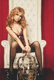 Woman in lingerie sitting on throne Royalty Free Stock Images