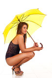 Woman in lingerie with umbrella Stock Photos