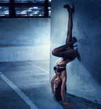 Woman in Lingerie in Upside Down Leaning on Wall Royalty Free Stock Image