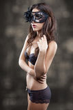 Woman in lingerie wearing a mask Stock Photo