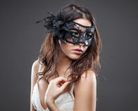 Woman in lingerie wearing a mask Stock Images