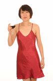 Woman in lingerie with wine Stock Images