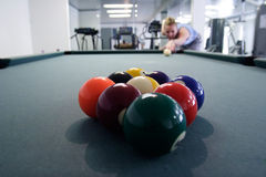 Woman lining up to break. In nine ball Royalty Free Stock Image