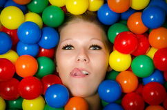 Woman with lip piercing and coloured balls Stock Image