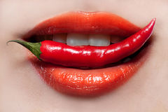 Woman Lips And Chili Pepper Stock Photos