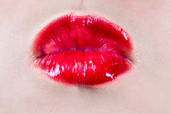 Woman lips blowing a kiss Royalty Free Stock Images