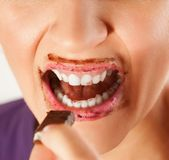 Woman lips and face covered in chocolate royalty free stock photos