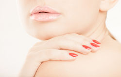 Woman lips and hand close-up Royalty Free Stock Photo