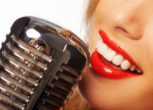 Woman lips with retro microphone royalty free stock images