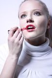 Woman with lipstick Royalty Free Stock Photography