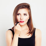 Woman with a Lipstick Stock Photography