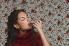 Woman with lipstick with floral background. Woman with lipstick over floral background Stock Images