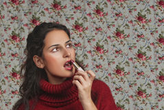 Woman with lipstick with floral background. Woman with lipstick over floral background Royalty Free Stock Photo
