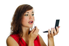 Woman with lipstick and mirrow. Stock Image