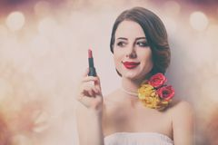 Woman with lipstick. Portrait of beautiful young woman with lipstick on the wonderful bokeh background Royalty Free Stock Images