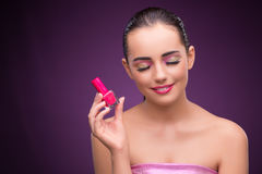 The woman with lipstick tube in beauty concept Royalty Free Stock Photography
