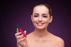 The woman with lipstick tube in beauty concept Royalty Free Stock Photo