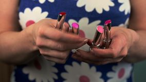 Woman with lipsticks in different colors stock footage