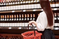 Woman in a liquor store royalty free stock photography