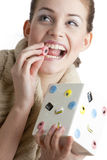 Woman with liquorice bonbon Stock Photos