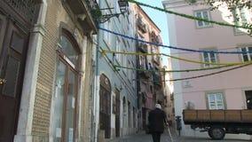 Woman in Lisbon, Portugal. An elderly woman walks into an alley in downtown Lisbon, Portugal stock video footage