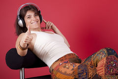 Woman listen music at her house Stock Photography