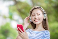 Woman listen music Stock Images