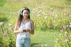 woman listen online music in park Royalty Free Stock Image