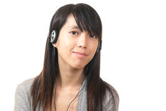 Woman listen to music Royalty Free Stock Photography