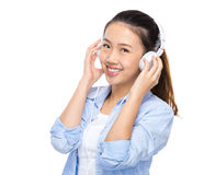Woman listen to music Stock Image