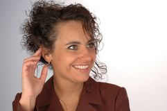 Woman listening. Laughing Royalty Free Stock Images