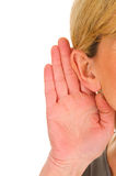 Woman listening Stock Photography