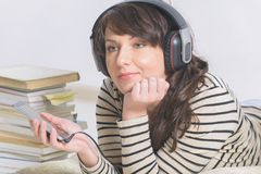 Woman listening an audiobook royalty free stock photo