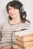 Woman listening an audiobook stock image