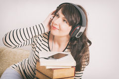 Woman listening an audiobook Royalty Free Stock Image