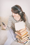 Woman listening an audiobook Stock Image