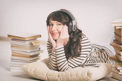 Woman listening an audiobook Royalty Free Stock Photography
