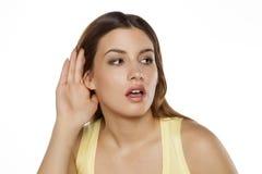 Woman listening carefully royalty free stock image