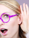 Woman listening carefully with hand close to ear Royalty Free Stock Photo