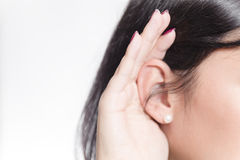 Woman listening closely. Isolated closeup Royalty Free Stock Photos