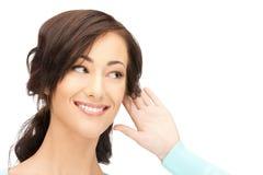Woman listening gossip Royalty Free Stock Image