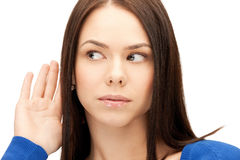 Woman listening gossip. Bright picture of young woman listening gossip Stock Image