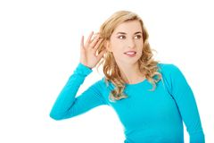Woman listening gossip Stock Photography