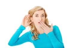 Woman listening gossip Royalty Free Stock Photos